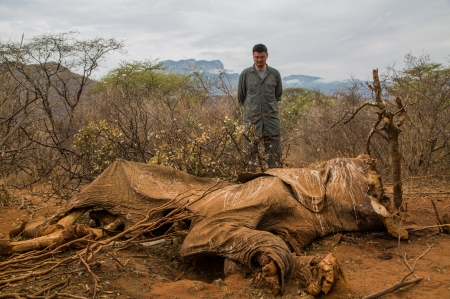 Yao Ming inspects the corpse of a poached elephant in Namunyak, Northern Kenya.