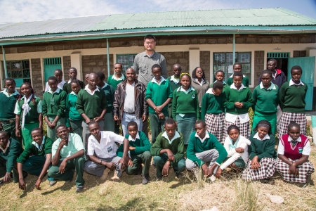 Yao Ming Poses with Students at a School in Ol Pejeta