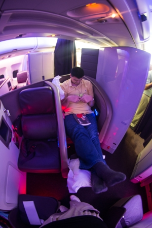 Yao Ming Relaxes on a Virgin Atlantic Flight